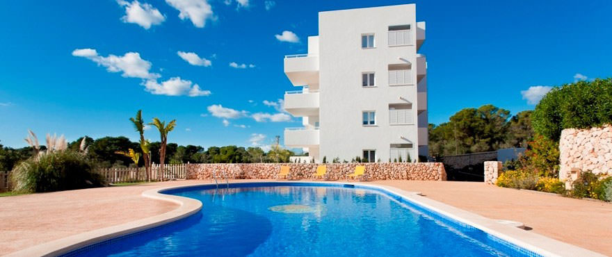 View from the swimming pool to the apartments El Puerto II in Cala DOr, Mallorca
