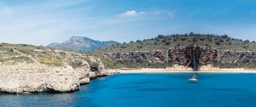 View of cove from the sea close to Cala Magrana III complex with apartments for sale