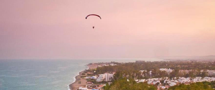 Sunset at San Pedro Beach in Marbella, next to apartments for sale on Los Arqueros Beach