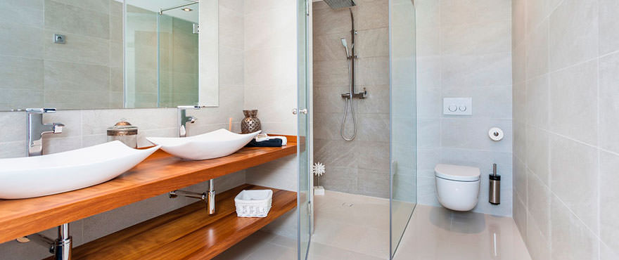 Luxurious bathroom with double sink, shower, toilet with high quality finishes
