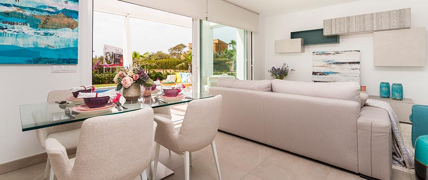 Spacious, bright living room – dining room of the new villa in Sa Rápita