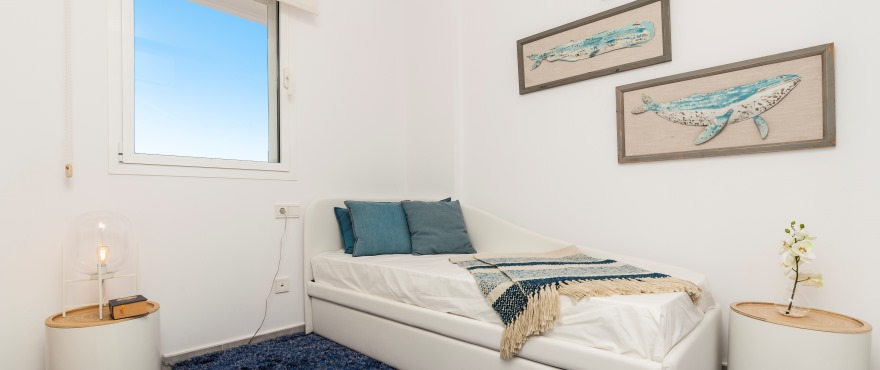 Bright bedroom in the new Acquamarina residential complex