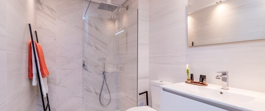 modern bathroom in the apartments for sale at Le Caprice