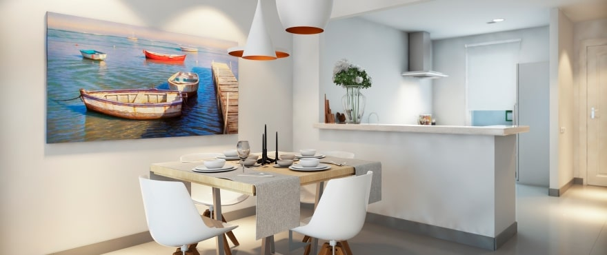Spacious living-dining room and open plan kitchen with breakfast bar at Blue Cove, Majorca