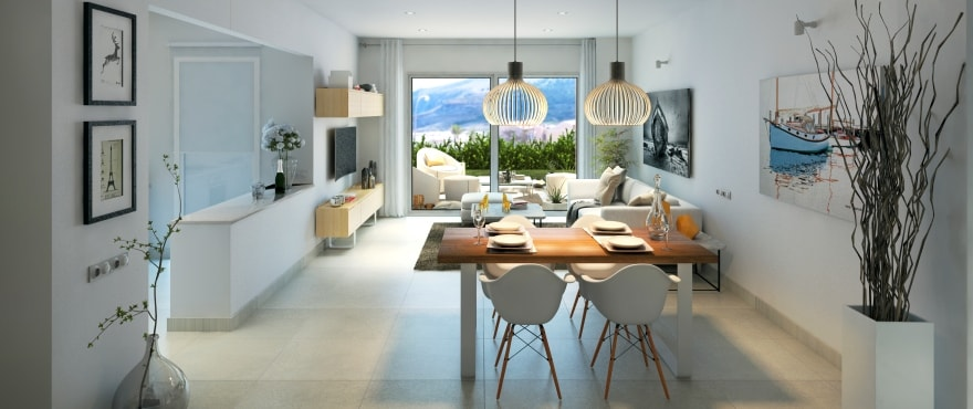 Bright living-dining room at Royal Blue, with a large terrace and sea views.
