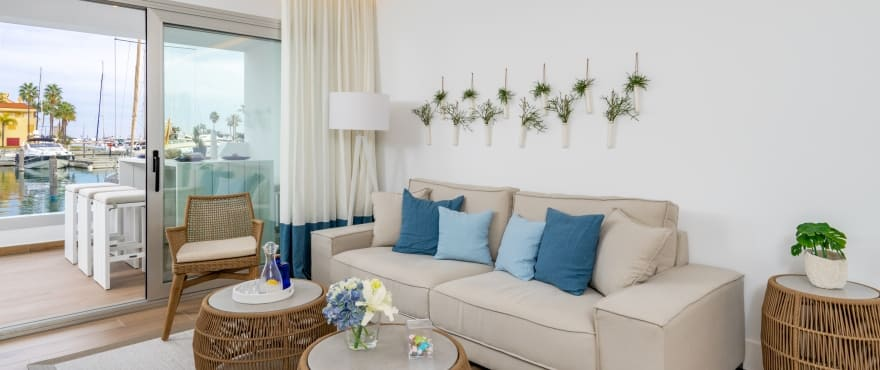 Pier, bright living room at the new apartments for sale in La Marina Golf