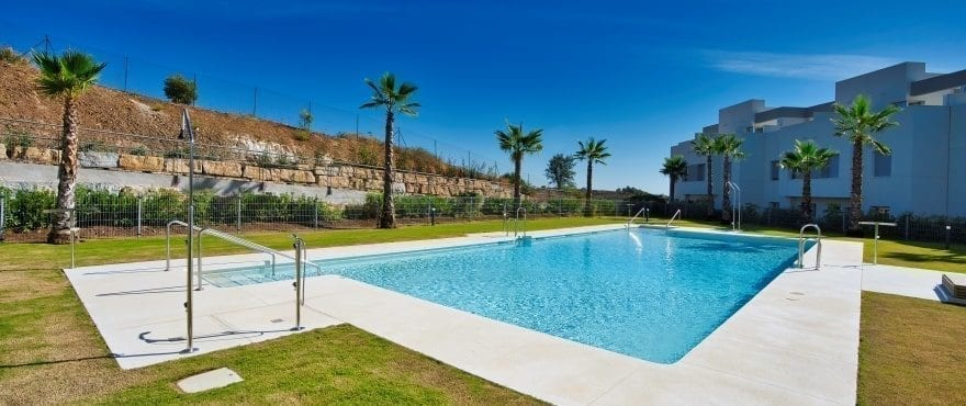 Communal pool and garden at the new homes at Natura