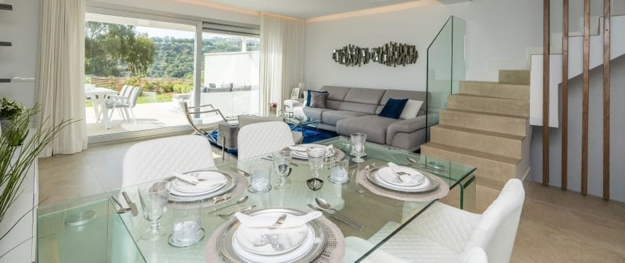 Bright living room with views of the golf course at the new townhouses for sale at Natura, Costa del Sol