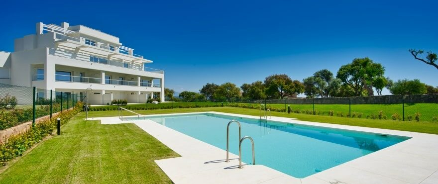 Communal pool and garden at Emerald Greens, San Roque Club