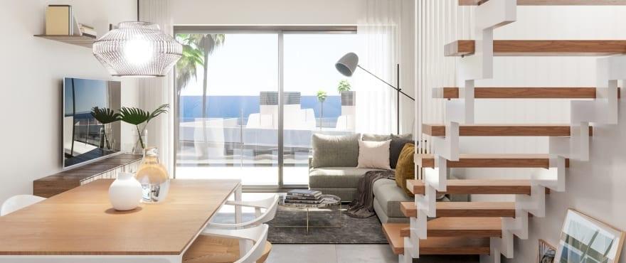 Ruime en goed licht doorlatende woonkamer met panoramisch uitzicht op de Middellandse Zee en het strand van Carabassí