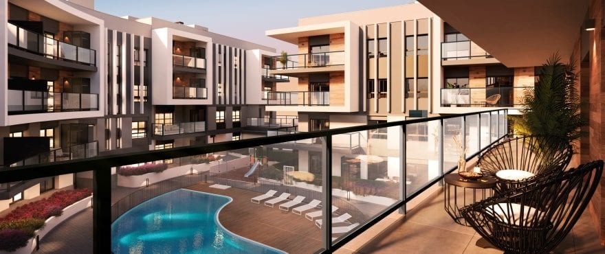 Modern apartments for sale in Jávea, with communal pools and gardens.